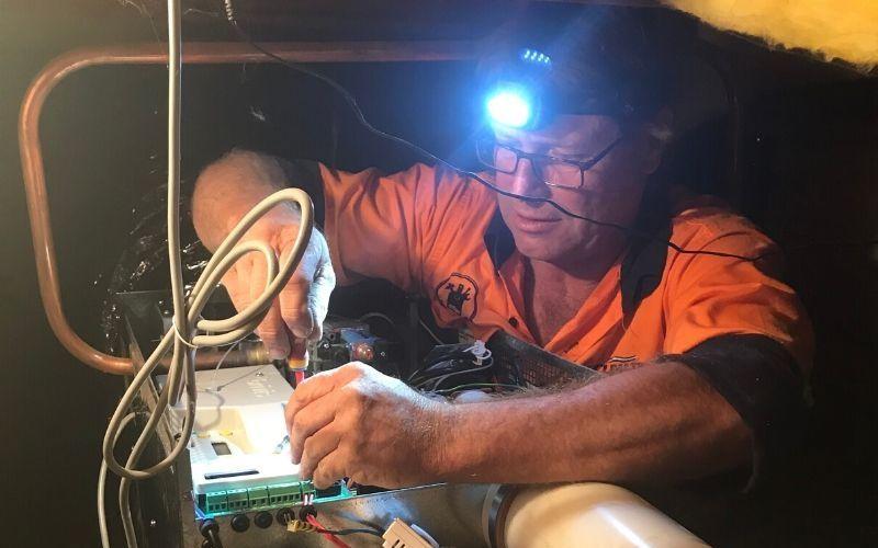 Service technician repairing a gas heater